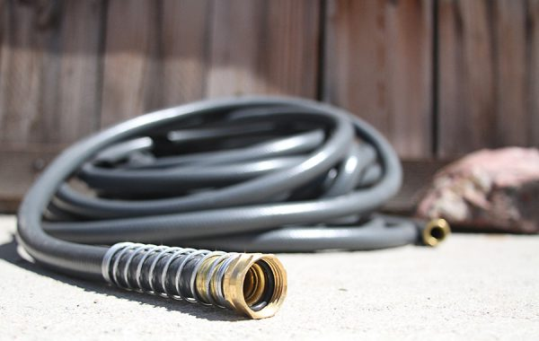 garden hose sitting on concrete